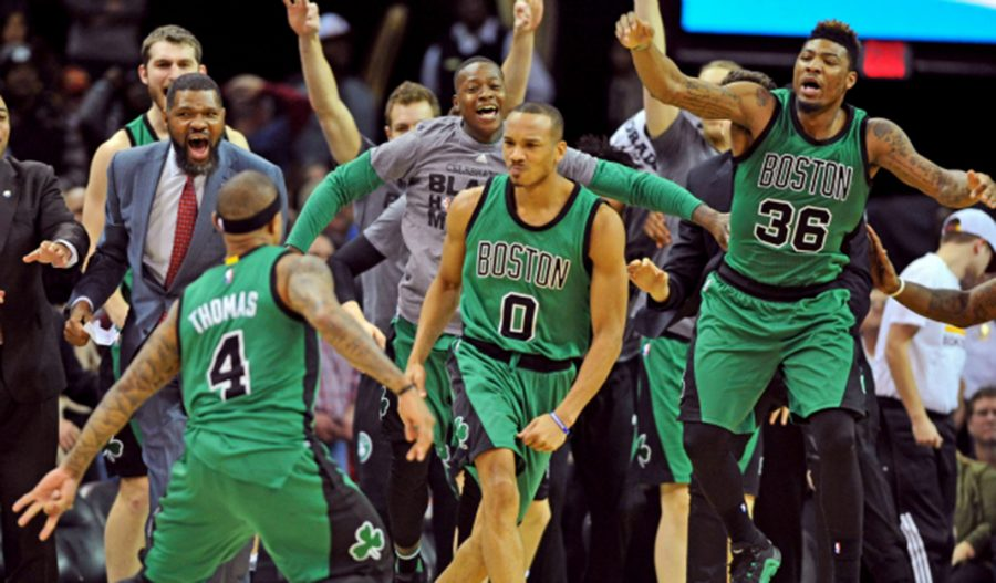 Feb 5, 2016; Cleveland, OH, USA; The Boston Celtics celebrate after guard Avery Bradley (0) reacts after hitting a three-point shot to end the game and beat the Cleveland Cavaliers  at Quicken Loans Arena. The Celtics won 104-103. Mandatory Credit: Ken Blaze-USA TODAY Sports