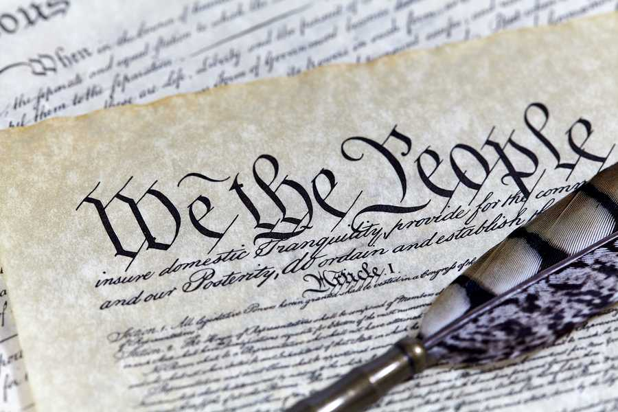 US Constitution Declaration of Independence Bill of Rights with a Quill pen and shallow depth of field
