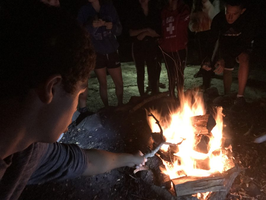 Students cook smores at camp for an evening activity. Photo by David Cutler 02.