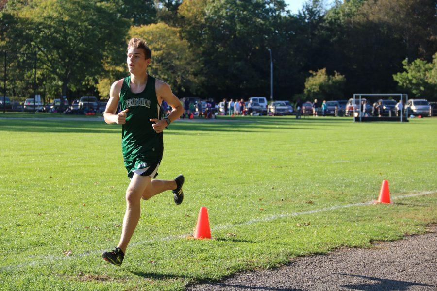 Co-Captain Connor Reif finishes first. Photo by Nicole DeCesare.