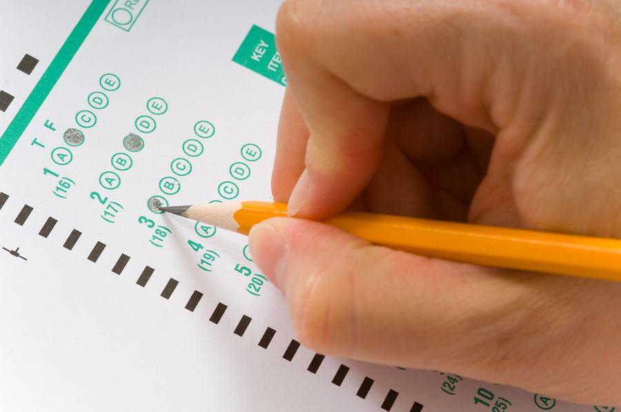 Taking+an+exam.+Photo+purchased+from+BigStock.com.