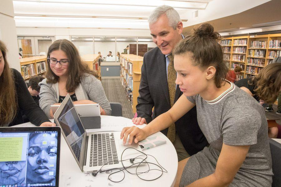Upper School Head Joshua Neudel sees what students are working on in the Writing Center area. Photo by David Barron.