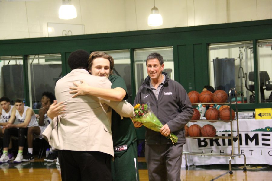 Dylan Rigol 18 celebrates his last home game, playing for the Gators. Photo by David Cutler.