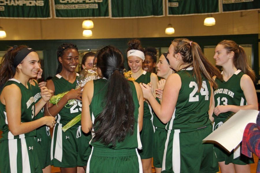 At her last home game, Amy Nwachukwu '18 celebrates with her team during halftime. Photo by David Cutler 02.