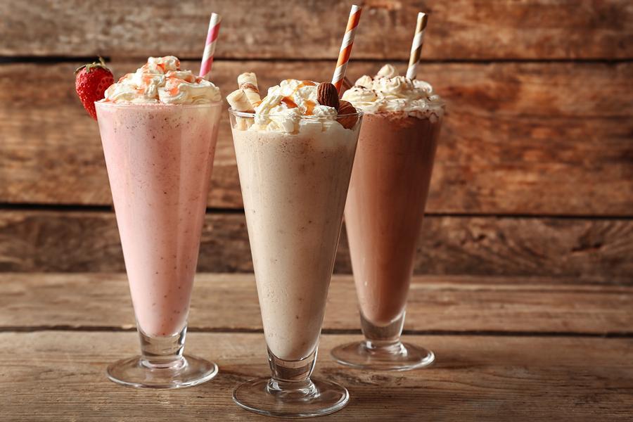 Delicious+milkshakes+on+wooden+background