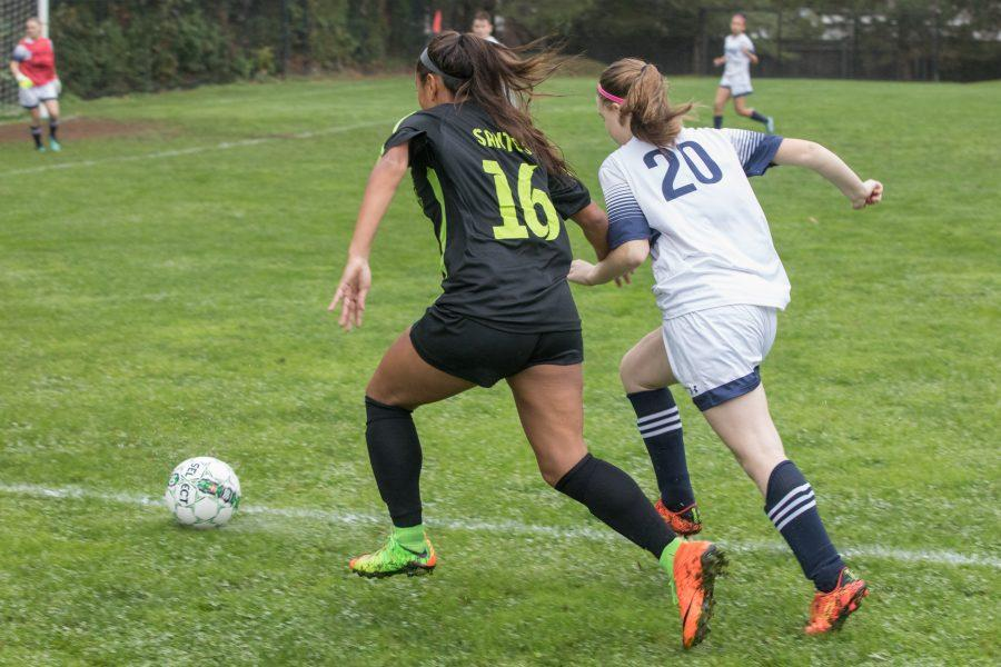 Kimberly Santos 18 fighting for a loose ball - Photo by David Barron