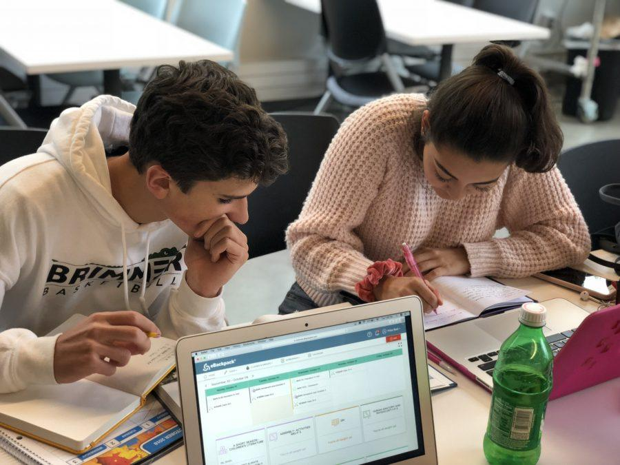 Paola Mammano 20 and Charles Marconi 20 working on a project. Photo By Sita Alomran 19