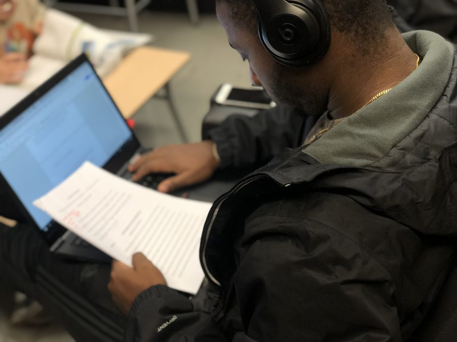 Benjamin Ernest '19 working on his English paper. Photo By Sita Alomran '19.