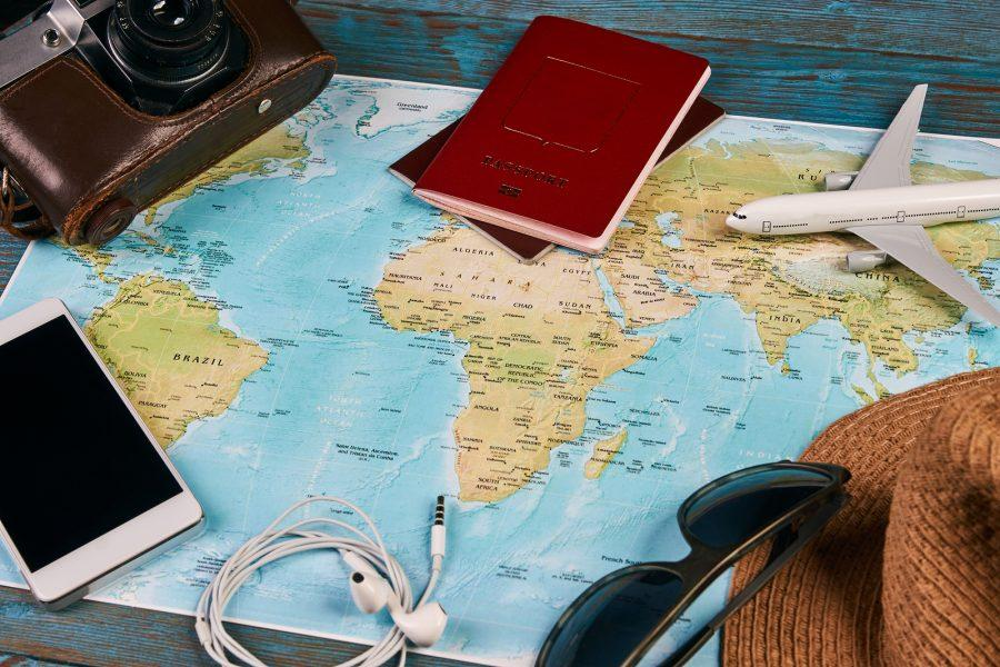 Passport%2C+photo+camera%2C+smart+phone%2C+sunglasses%2C+straw+hat+and+travel+map%2C+traveler+items+vacation+travel+accessories+holiday+long+weekend+day+off+travelling+stuff+equipment+background+view+concept