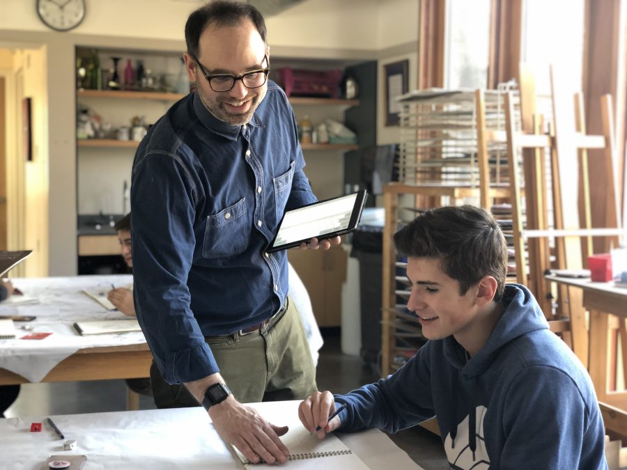Brent Ridge helping Charlie Marconi '20 with his art work. Photo by Sita Alomran 19.