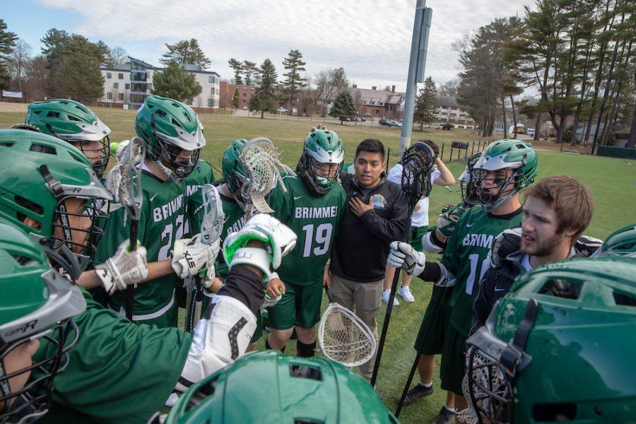 The+team+huddles+at+halftime+against+Waring.+Photo+by+David+Barron.+