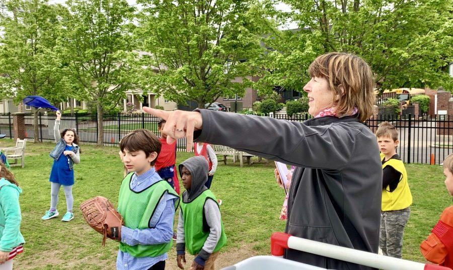 Physical+education+teacher+Kim+Woods+organizes+outdoor+tennis-baseball.+Photo+by+David+Cutler.+