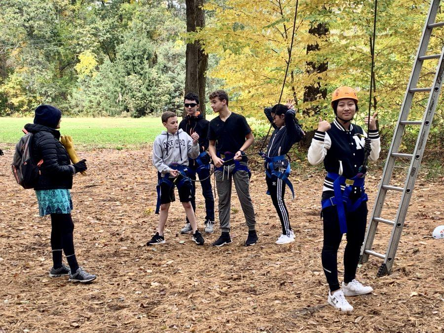 Hebe Qiang 23 gets ready to do the ropes course.  Photo by Edan Zinn 23.