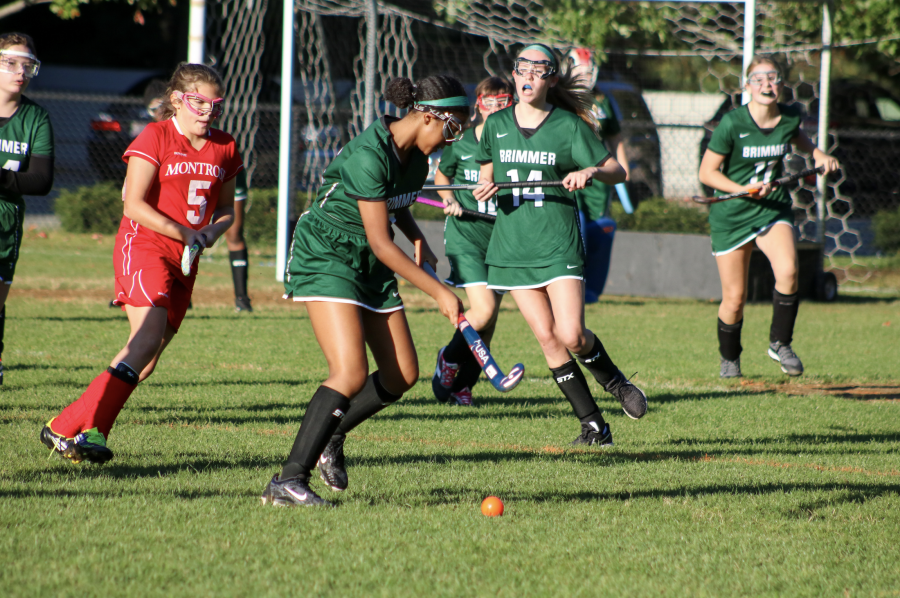 Behare+Goshime+22+takes+possession+of+the+ball%2C+as+her+team+offers+support.+Photo+courtesy+of+Brimmer+and+May+School.+