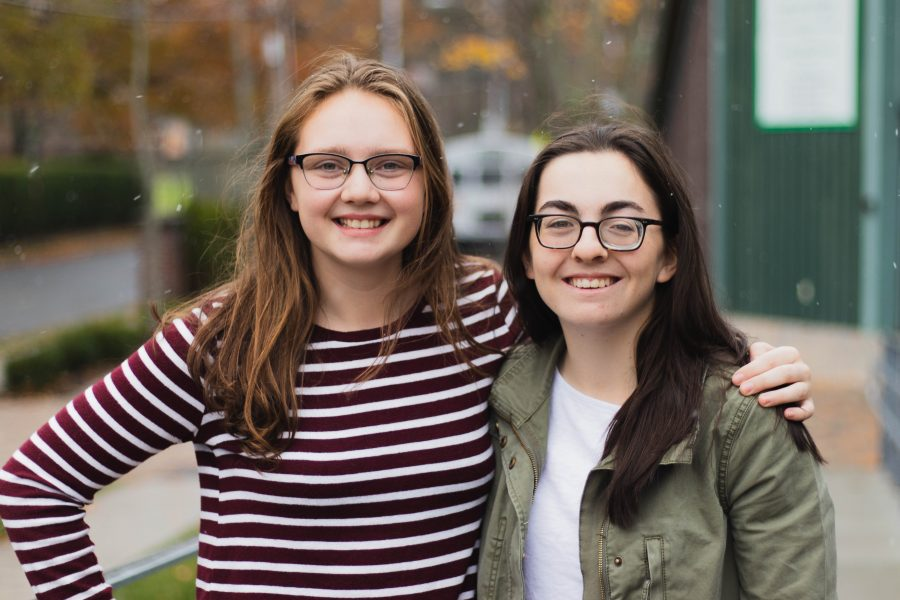 Multimedia Manager Spring '22 (left) enjoys an outdoor break in snow with outgoing Co-Editor-in-Chief Caroline Champa '20.