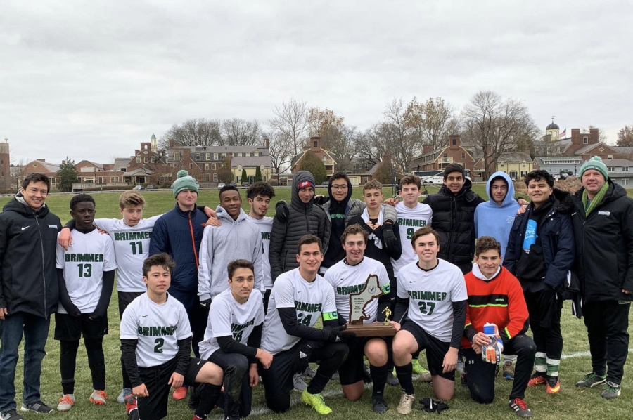The+team+poses+after+competing+in+the+NEPSAC+championship%2C+showing+off+the+second-place+trophy.+Photo+courtesy+of+Brimmer+and+May.