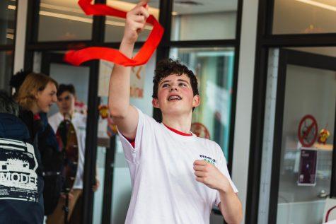 Kieran Cross 23 spins a ribbon.