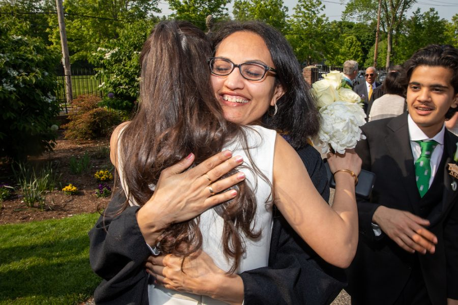 Sita Alomran 19 hugs math teacher Rupa Houndelga before last years graduation ceremony. These final embraces will be missed this spring.