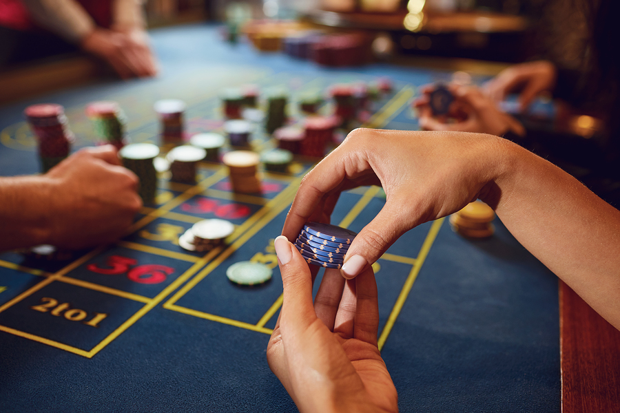 Gamer+play+casino+roulette+at+a+table+in+a+casino.+Betting+gambling+poker+roulette+background+concept.+Photo+purchased+from+BigStock.com.