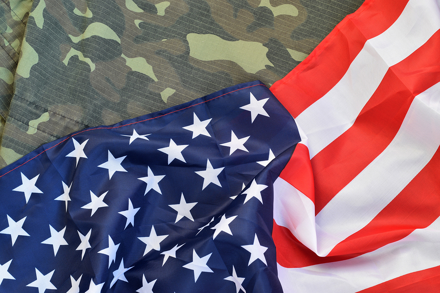 American+flag+and+folded+military+uniform+jacket.+Photo+purchased+from+BigStock.com.+