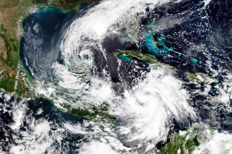 Hurricane Delta and Tropical Storm Gamma in October 2020. Photo courtesy of Wikimedia Commons.