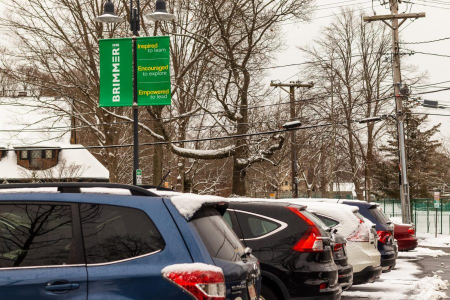 Cars parked in the gym parking lot. Photo illustration by Edan Zinn 23.