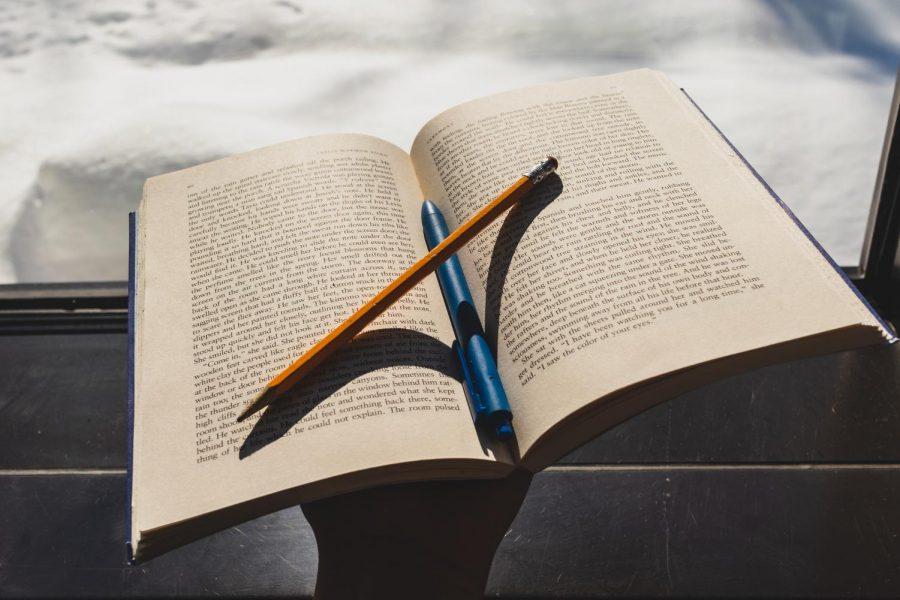 Papas uses sensitivity readers while editing her fiction writing. Photo illustration by Edan Zinn 23.