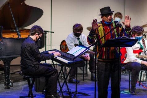 Terry E. Carter recites poetry while Jonathan Fagan plays the piano.