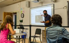 Upper School History Teacher Ted Barker-Hook gives a lesson on The New York Times.