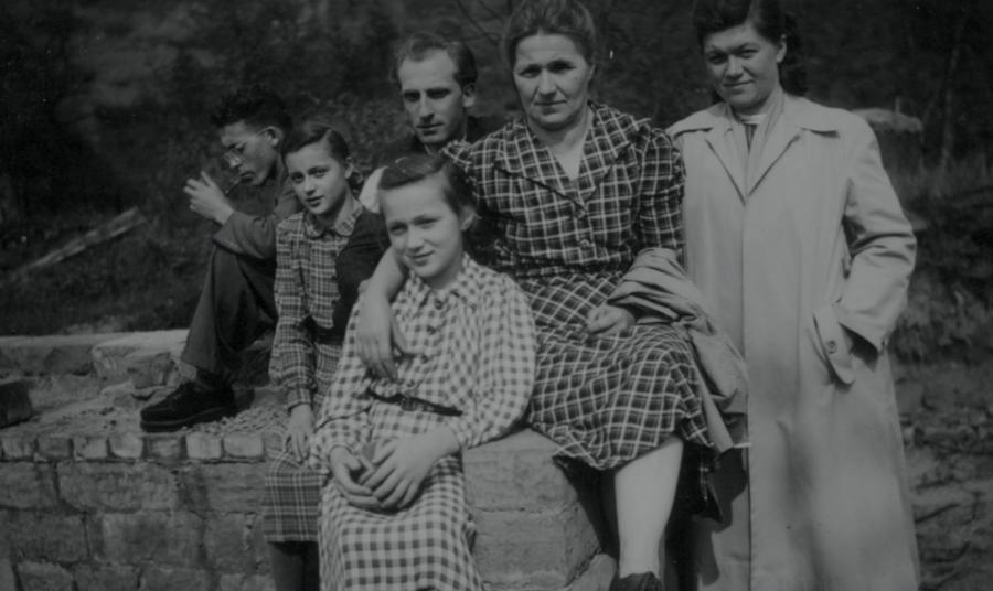 Christa Katsenes (from left) sits alongside her mother and older siblings.