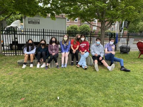 The group of eight students pose on the gator bench they constructed.