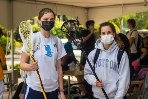 Leni Hicks-Dutt 23 and Sophia Bruno 23 pose before lacrosse practice.