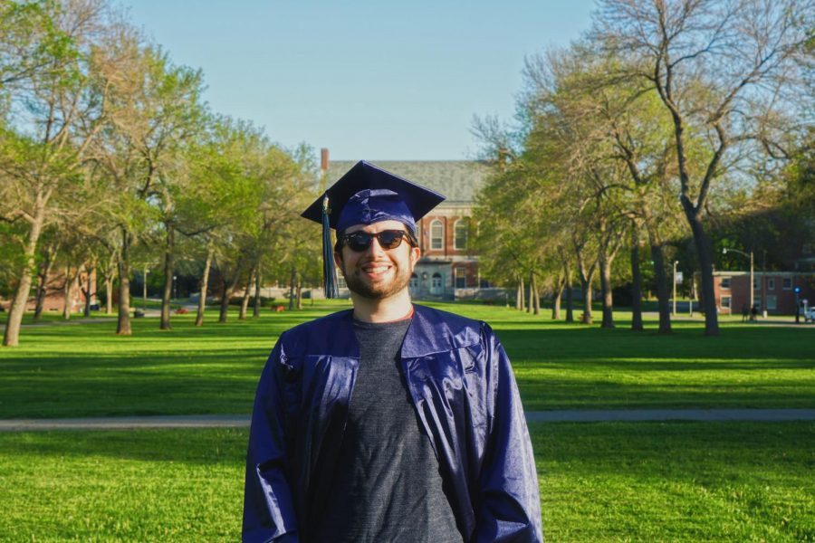 Photo courtesy of Evan Holman, posing in his regalia from the University of Maine.