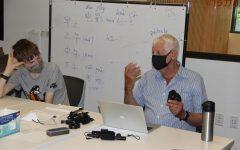 Digital cinema teacher Eric Neudel introduces students to FinalCut Pro.