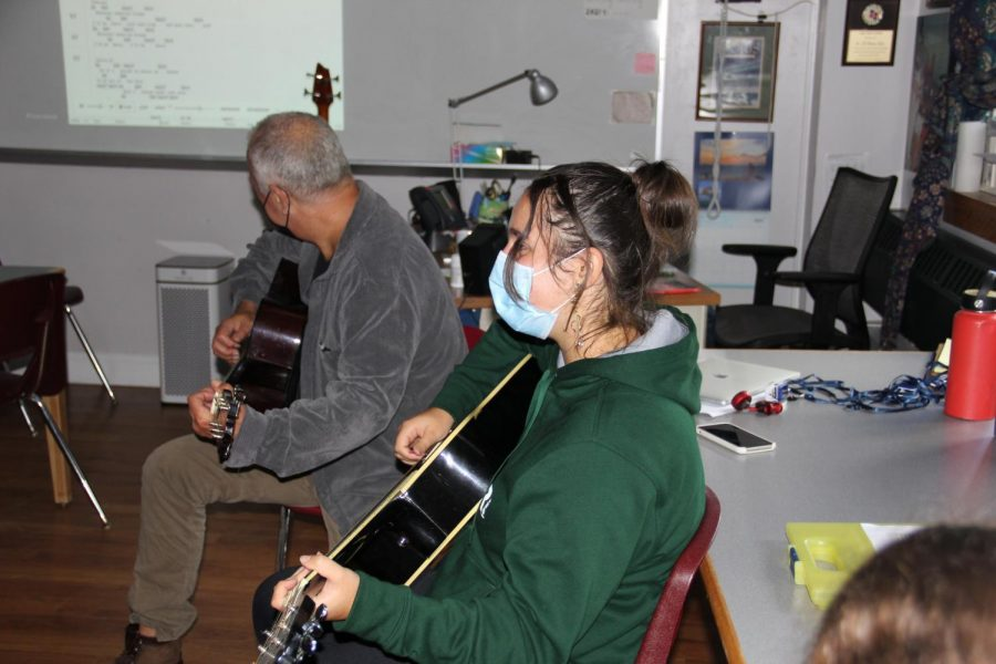Grace Papas 23 jams out with Bill Jacob during acoustic music club.