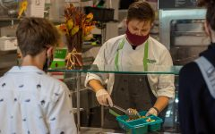 Sous Chef Taran Gavrin serves an Upper School student at lunch.